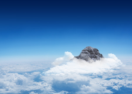 digitally  generated: Digitally generated Mountain peak through the clouds Stock Photo