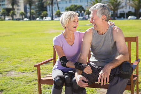 elbow pads: Active senior couple ready to go rollerblading on a sunny day Stock Photo