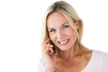 Happy blonde talking on the phone on white background