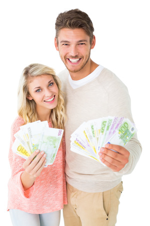 Attractive couple flashing their cash on white background