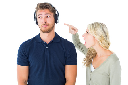 Young couple having an argument on white background photo