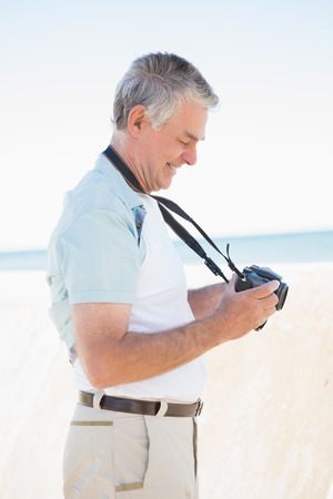 chinos: Happy senior man looking at his camera on a sunny day Stock Photo