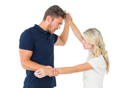 overpowering: Angry man overpowering his girlfriend on white background