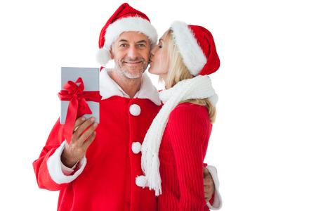 Festive couple embracing and holding gift on white background photo