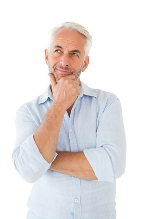 man looking out: Thoughtful man posing with hand on chin on white background Stock Photo
