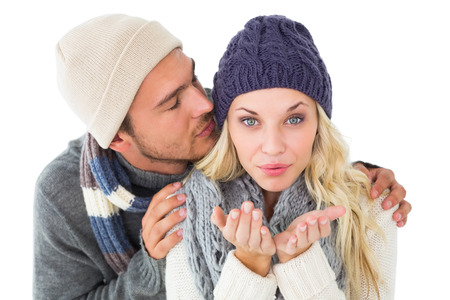 Attractive couple in winter fashion on white background photo