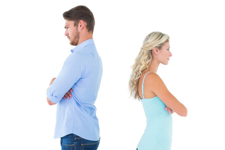 exasperated: Unhappy couple not speaking to each other on white background