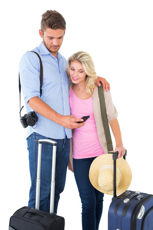 Attractive young couple ready to go on vacation on white background photo