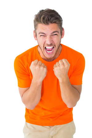 excited man: Excited man in orange cheering on white background
