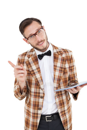 Happy nerd holding tablet pc and pointing on white background photo