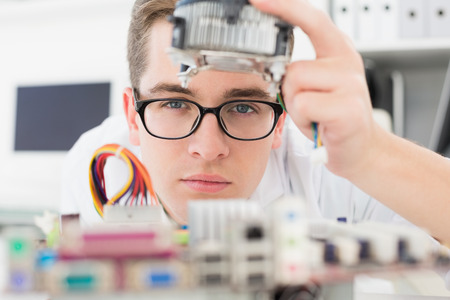 Technician working on broken cpu in his office Stock Photo