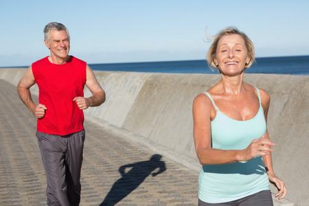 Active senior couple out for a jog on a sunny day