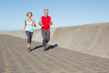 active seniors: Active senior couple out for a jog on a sunny day