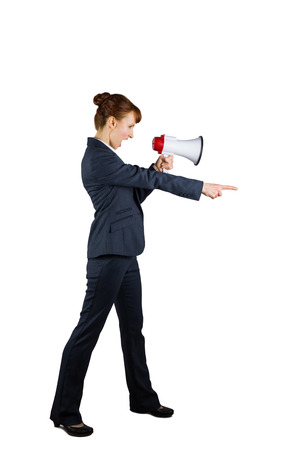 Angry businesswoman shouting through megaphone and pointing on white background photo