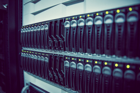 mounted: Black rack mounted server tower in large data center Stock Photo