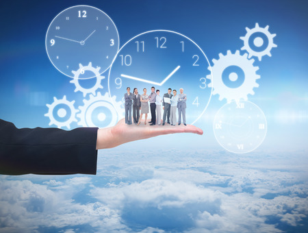computing machine: Business team looking at camera against blue sky over clouds at high altitude Stock Photo