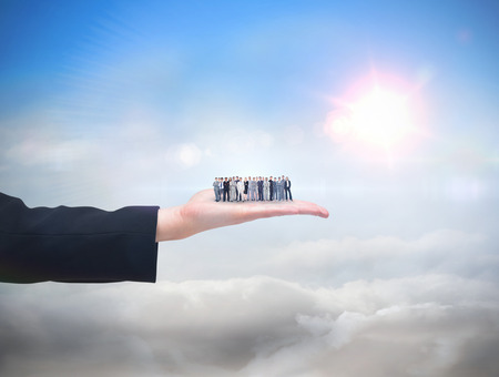 Business people standing up against blue sky with sunshine and clouds photo