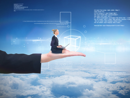 Businesswoman using laptop against blue sky over clouds at high altitude photo