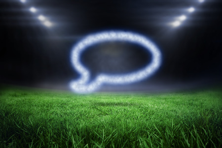 Cloud in shape of speech bubble against football pitch with bright lights photo