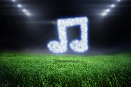 quaver: Cloud in shape of quaver against football pitch with bright lights