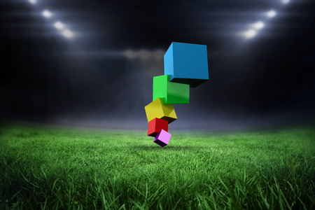 wobbly: Pile of 3d colourful cubes against football pitch with bright lights Stock Photo