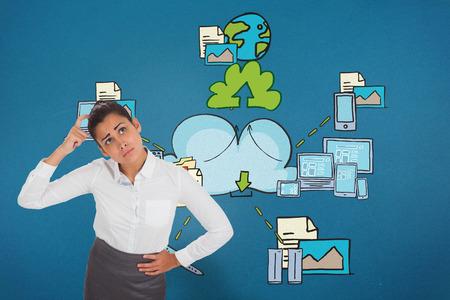 Worried businesswoman against cloud computing doodle photo