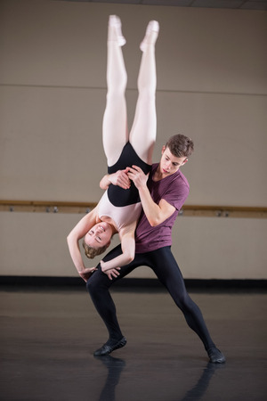 gracefully: Ballet partners dancing gracefully together in the ballet studio