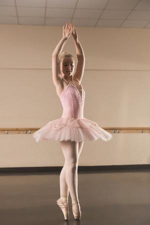 Beautiful ballerina dancing en pointe in the dance studio photo