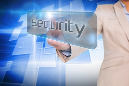 Businesswoman pointing to word security against background with shiny squares photo
