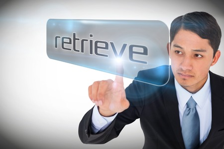 retrieve: Businessman pointing to word retrieve against white background with vignette Stock Photo
