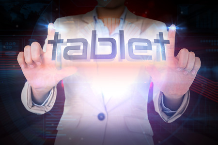 Businesswoman presenting the word tablet against shiny red statistic on black background photo