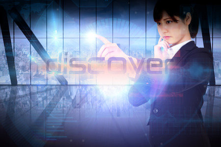 Businesswoman presenting the word discover against room with large window looking on city photo