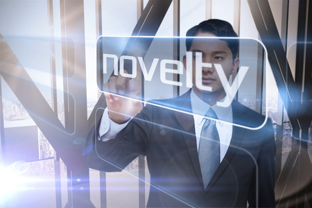 the novelty: Businessman presenting the word novelty against room with large window looking on city