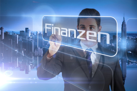 finanzen: Businessman presenting the word finance in german against mirror image of city skyline