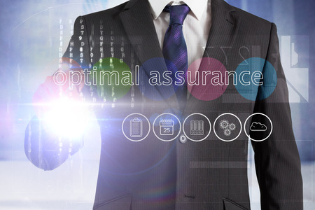 optimal: Businessman touching the words optimal assurance on interface against urban projection on wall