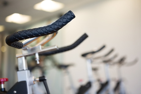 leisure equipment: Row of exercise bikes focus on foreground at the leisure center
