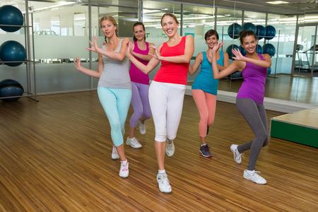 Zumba class dancing in studio at the gym Stock Photo