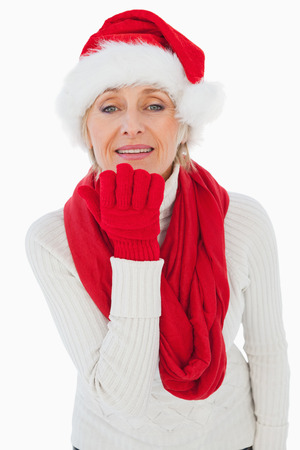 Festive woman blowing a kiss on white background photo