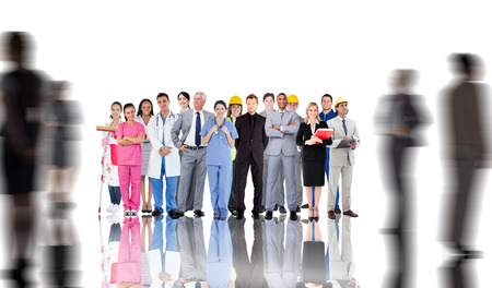 Smiling group of people with different jobs with silhouettes of business people photo