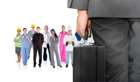 Composite image of businessman holding briefcase against group of workers photo