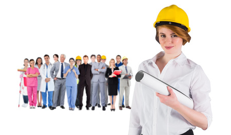 Composite image of pretty young architect smiling at camera against group of workers photo