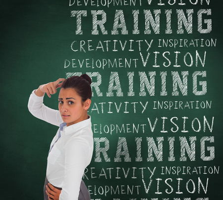 buzzwords: Worried businesswoman against green chalkboard with business buzzwords