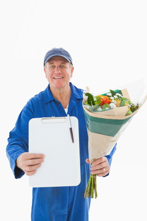 boiler suit: Happy flower delivery man showing clipboard on white background