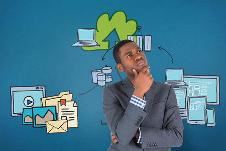 Young businessman thinking against cloud computing doodle photo