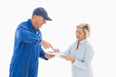 boiler suit: Happy delivery man with customer on white background Stock Photo