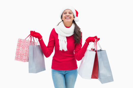 Beautiful festive woman holding shopping bags on white background photo