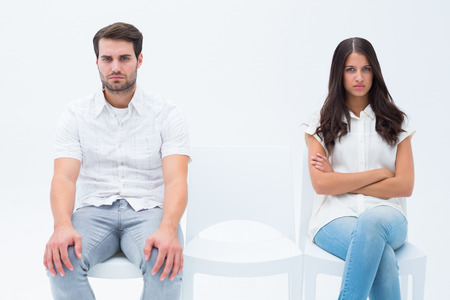 not talking: Angry couple not talking after argument on white background