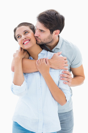 Cute couple hugging and smiling on white background photo