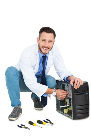 cut out device: Handsome computer engineer working at open computer on white background