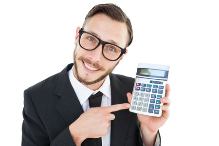 Geeky businessman pointing to calculator on white background photo